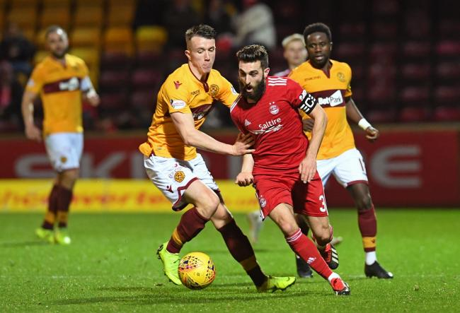 Motherwell's David Turnbull, left, competes with Aberdeen's Graeme Shinnie last season.