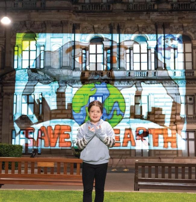 """ Calderbuilt Primary School's Sophie Mitchell had her artwork projected onto City Chambers as she joined council officials, business representatives and other participants at the Clean Air Day launch in Glasgow"