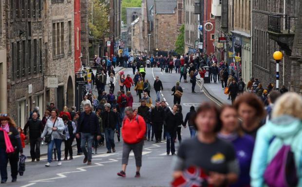 HeraldScotland: Edinburgh residents and visitors make the most of traffic-free streets.