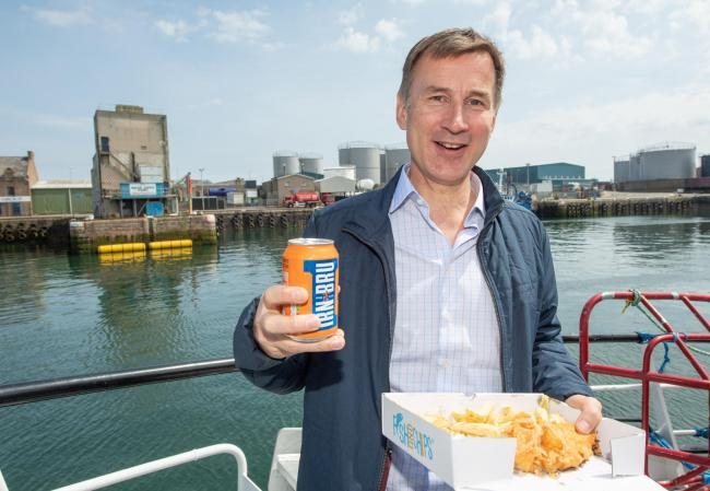 Conservative party leadership candidate Jeremy Hunt has some fish and chips and a can of Irn Bru during his visit to Peterhead in Aberdeenshire.