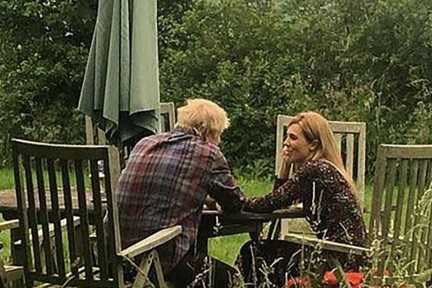 Boris Johnson and Carrie Symonds publish 'loved up' photos