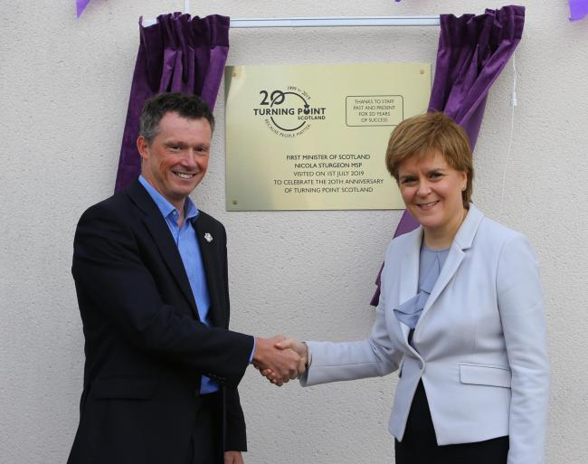 First Minister Nicola Sturgeon MSP pictured with Turning Point Scotland Chief Executive Neil Richardson. Photograph by Colin Mearns