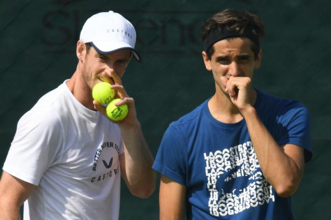 Andy Murray trains with doubles partner Pierre-Hugues Herbert at Wimbledon yesterday
