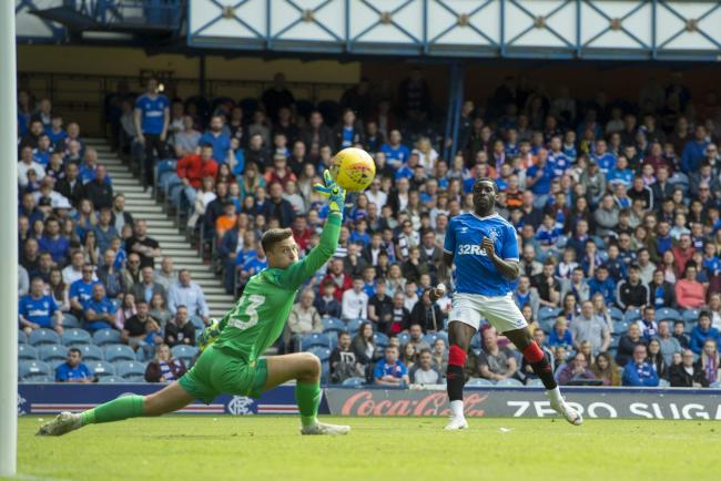 Sheyi Ojo scores the fourth goal as he beats Oxford keeper Jack Stevens during the pre-season friendly at Ibrox
