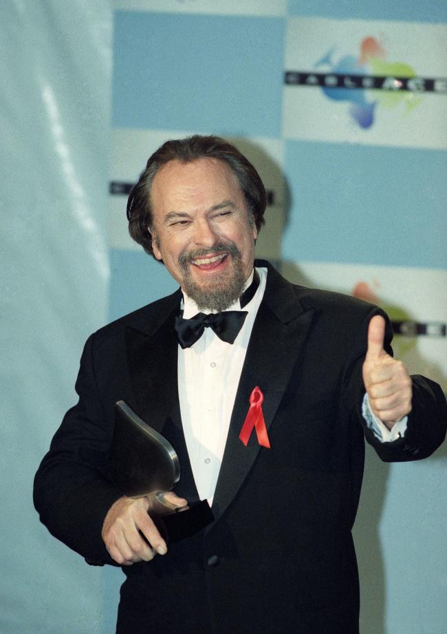 "FILE - In this Jan. 15, 1995, file photo, actor Rip Torn gives a thumbs-up to photographers after winning for Best Actor in a Comedy Series for HBO's ""The Larry Sanders Show,"" at the 16th annual CableACE Awards ceremony, in Los Angeles. Awar"