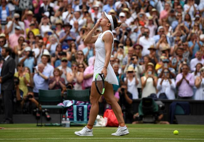 LONDON, ENGLAND - JULY 13: Simona Halep of Romania celebrates victory in the Ladies' Singles final against Serena Williams of The United States during Day twelve of The Championships - Wimbledon 2019 at All England Lawn Tennis and Croquet Club on July