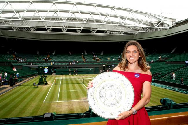 LONDON, ENGLAND - JULY 14: 2019 Ladies' Singles Champion, Simona Halep of Romania poses for a photo with the trophy in the Royal Box on centre court during Day thirteen of The Championships - Wimbledon 2019 at All England Lawn Tennis and Croquet Club