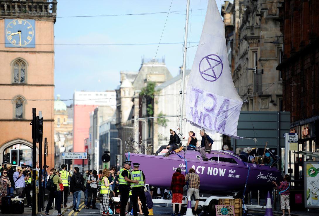 Extinction Rebellion campaigners blockade Glasgow road | HeraldScotland