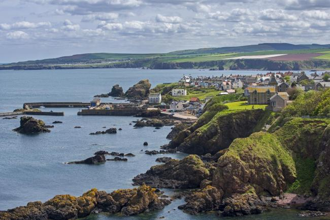 The fishing village of St Abbs seen from the southern side of St Abb's Head.