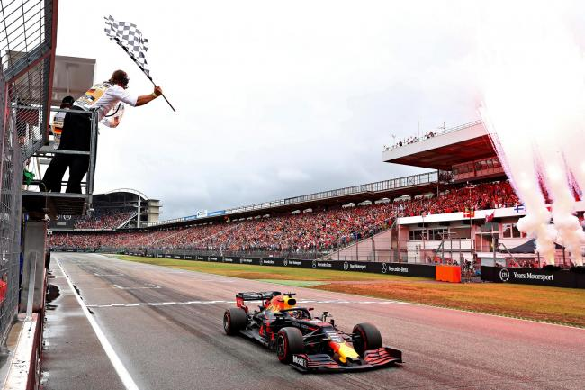 HOCKENHEIM, GERMANY - JULY 28: Race winner Max Verstappen of the Netherlands driving the (33) Aston Martin Red Bull Racing RB15 takes the chequered flag and the win during the F1 Grand Prix of Germany at Hockenheimring on July 28, 2019 in Hockenheim, Germ