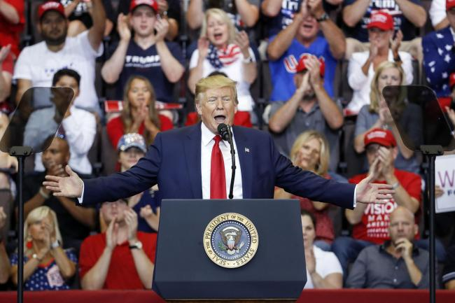 President Donald Trump speaks at a campaign rally at U.S. Bank Arena, Thursday, Aug. 1, 2019, in Cincinnati. (AP Photo/John Minchillo).