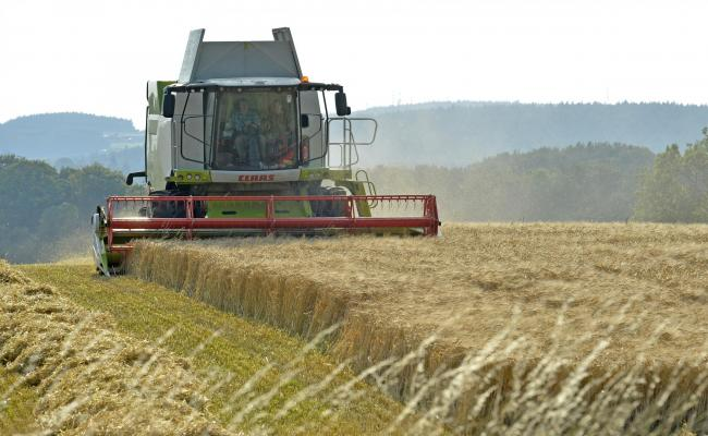File photo dated 10/09/15 of a combine harvester in a field. The world must