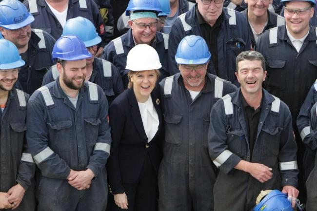 First Minister Nicola Sturgeon with staff at Ferguson Marine.