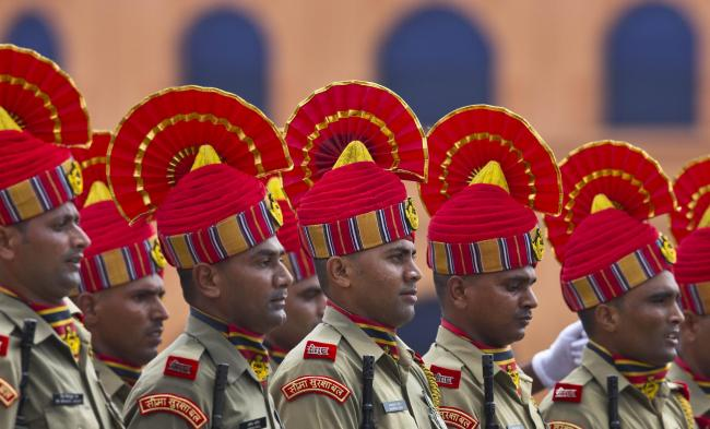 Indian Sashastra Seema Bal personnel take part in the Independence Day celebration parade in Gauhati, India, Thursday, Aug. 15, 2019. Indian Prime Minister Narendra Modi defended his government's controversial measure to strip the disputed Kashmir reg