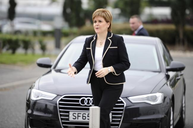 GLASGOW, SCOTLAND - SEPTEMBER 03: Scotland's First Minister Nicola Sturgeon is seen using a diesel car (Audi) to travel to a photocall for electric vehicles from the emergency services to announce funding on low emission vehicles and charging infrastr