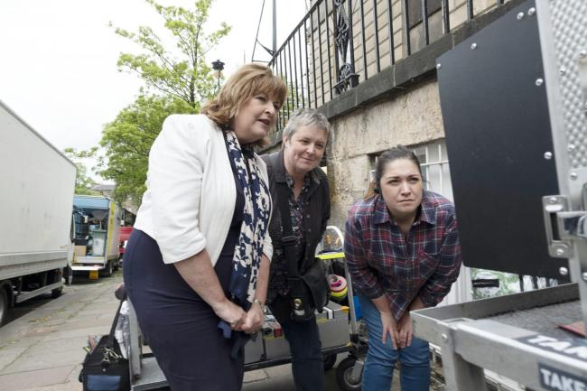 Culture Secretary Fiona Hyslop, left, with producer Jules Hussey and third assistant director Amy Hogarth on the set of Guilt in Edinburgh.