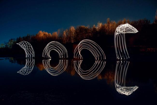 A composite image made by photographer Mark Harris of the Nessie the Loch Ness Monster painted with light on the shores of the River Clyde in Dumbarton, West Dunbartonshire. See SWNS story SWSCnessie; This astonishing photograph shows the Loch Ness Monste