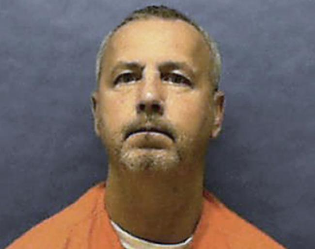 In this undated photo provided by the Florida Department of Corrections, Gary Ray Bowles is shown. Bowles, a serial killer who preyed on older gay men during an eight-month spree in 1994 that left six dead, was executed by lethal injection Thursday, Aug.