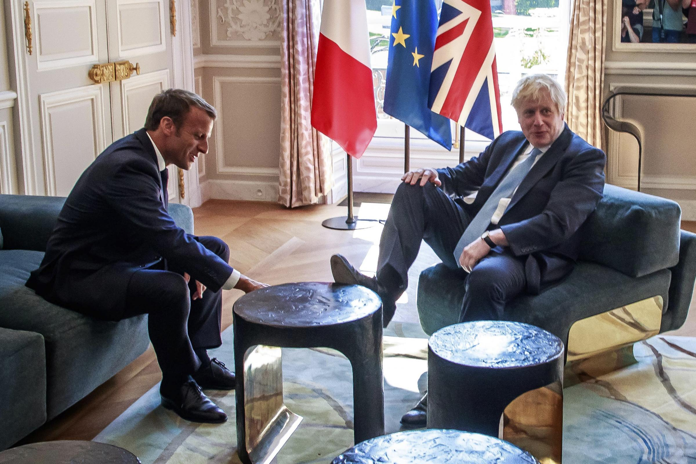 Boris Johnson branded an embarrassment after putting feet on Macron's table