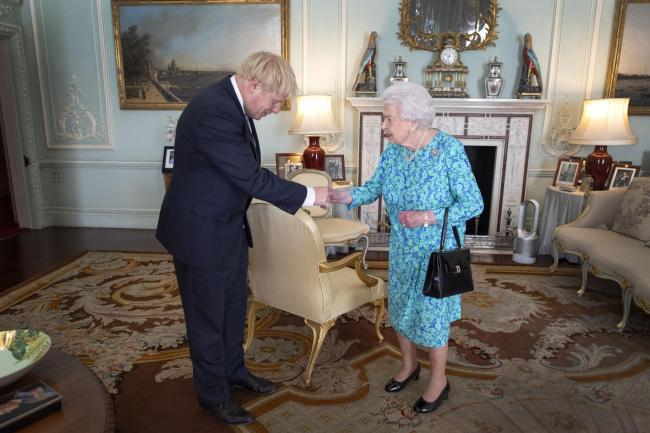 File photo dated 24/07/19 of Queen Elizabeth II inviting Boris Johnson to become Prime Minister and form a new government during an audience in Buckingham Palace. Mr Johnson has his week received permission from teh Queen for an extended suspension of Par