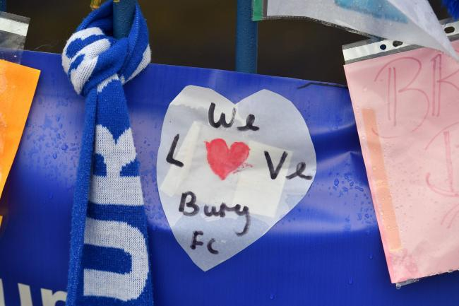 Messages from Bury supporters are placed on a fence outside Gigg Lane stadium. The 134-year-old club have been expelled from the English Football League, a move that is likely to result in them being liquidated