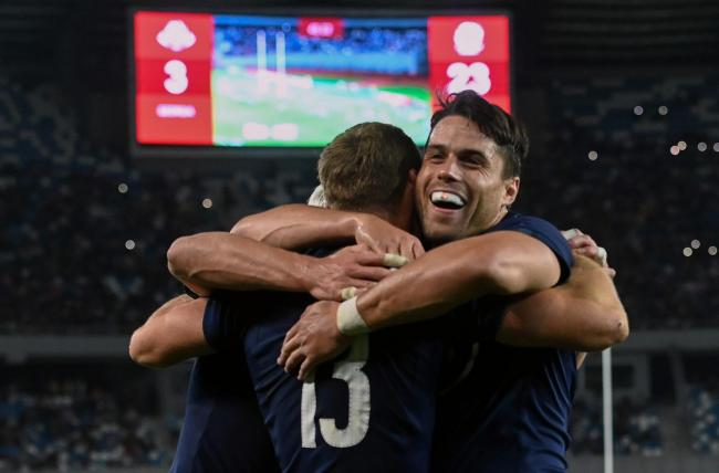 Scotland's centre Rory Hutchinson  is congratulated by team-mates including Sean Maitland (right) after scoring a try during the international Test match against Georgia