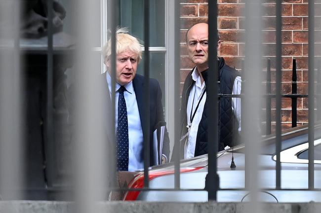 Prime Minister Boris Johnson (L) and his special advisor Dominic Cummings leave from the rear of Downing Street in central London on September 3, 2019, before heading to the Houses of Parliament.