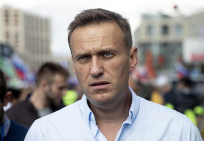FILE - In this Saturday, July 20, 2019, file photo, Russian opposition leader Alexei Navalny attends a protest in Moscow, Russia. Navalny remained hospitalized for a second day on Monday, July 29, 2019, after his physician said he may have been poisoned.