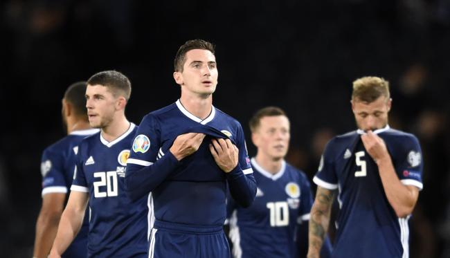 Scotland's Kenny McLean (centre) appears dejected after the final whistle of the UEFA Euro 2020 Qualifying, Group I match at Hampden Park, Glasgow. PA Photo. Picture date: Friday September 6, 2019. See PA story SOCCER Scotland. Photo credit should rea