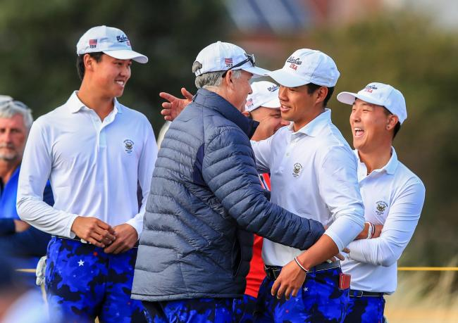 USA's captain Nathanial Crosby celebrates with his players after winning the Walker Cup