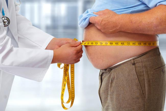 People tend to gain weight in middle age because the body becomes less efficient at burning fat