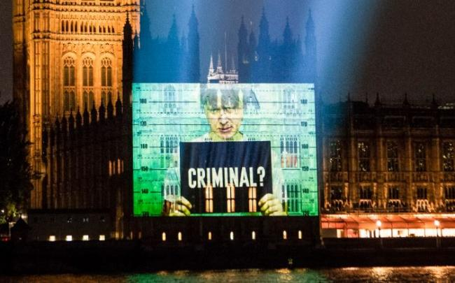 Boris Johnson depicted as criminal in giant Parliament projection