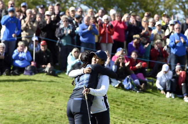 Celine Boutier and Georgia Hall celebrate winning a point for Europe at the Solheim Cup