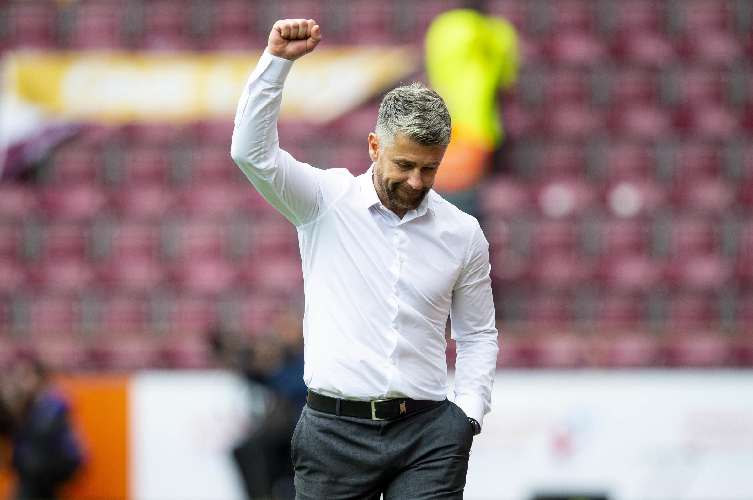 Motherwell boss Stephen Robinson tries not to add fuel to the fire as speculation mounts over his future