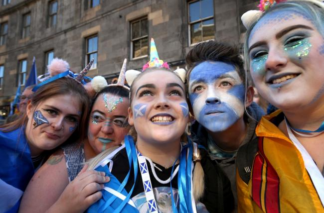 Young pro-independence demonstrators take part in a march through Edinburgh, during the All Under One Banner march. PRESS ASSOCIATION Photo. Picture date: Saturday October 6, 2018. Photo credit should read: Jane Barlow/PA Wire.