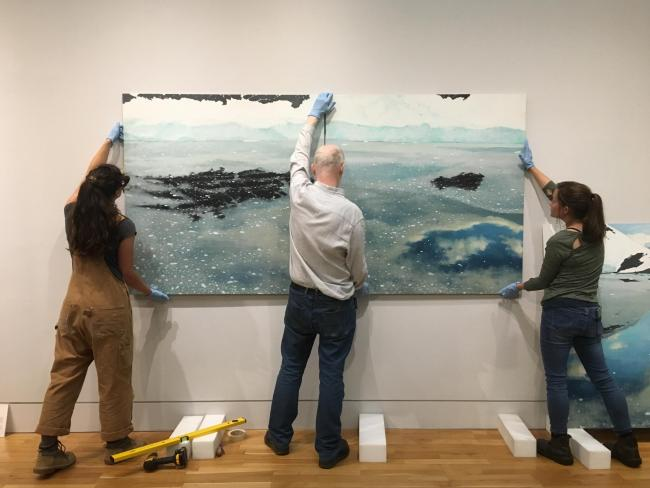 The team at The McManus: Dundee's Art Gallery & Museum installing a stunning triptych by Frances Walker as part of their new display