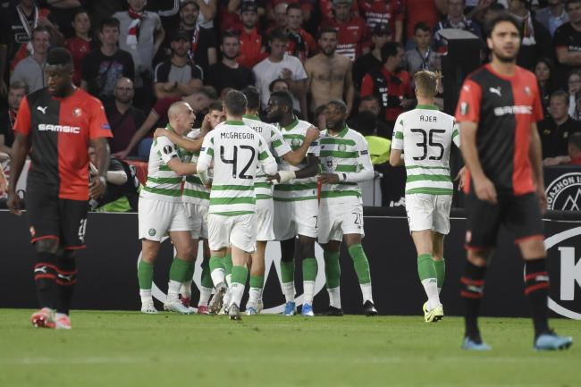 The Celtic players celebrate after Ryan Christie levels the scores
