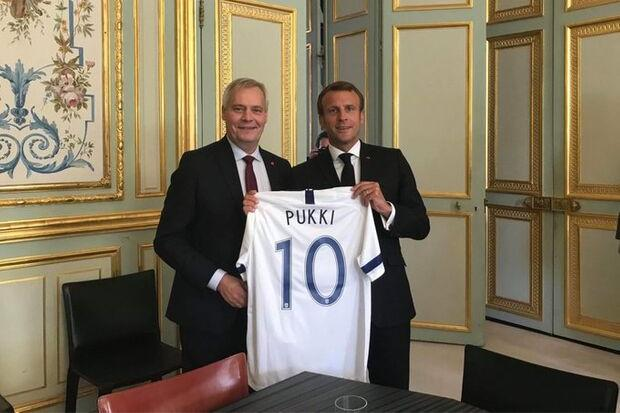 Ex-Celtic striker Teemu Pukki's jersey given to France leader Emmanuel Macron by Finland PM in bizarre gifting