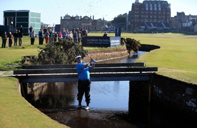 Chris Doak plays out of the burn during the Dunhill Links at St Andrews
