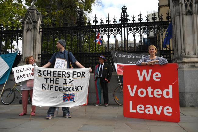 Protesters outside Parliament yesterday as MPs returned from their enforced absence.
