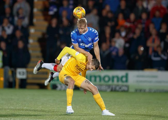 Rangers's Filip Helander and Livingston's Lyndon Dykes