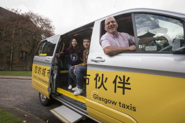 "Glasgow Taxis with slogan ""Your City's Friend""."