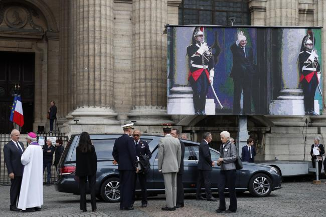 Officials wait by the hearse of late French President Jacques Chirac.