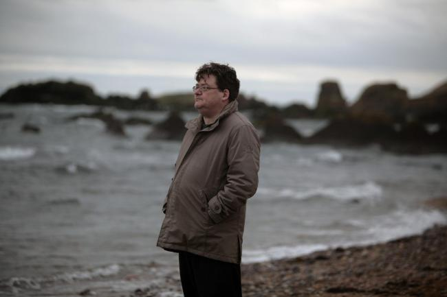 Author and poet John Burnside pictured in St Monans Fife by the harbour 27/2/12.