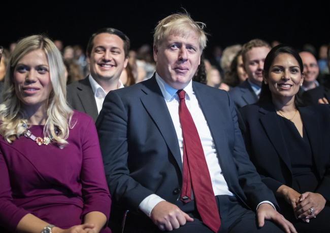 Prime Minister Boris Johnson with Home Secretary Priti Patel (right) at the Conservative Party Conference at the Manchester Convention Centre. PA Photo. Picture date: Monday September 30, 2019. See PA story TORY Main. Photo credit should read: Danny Laws