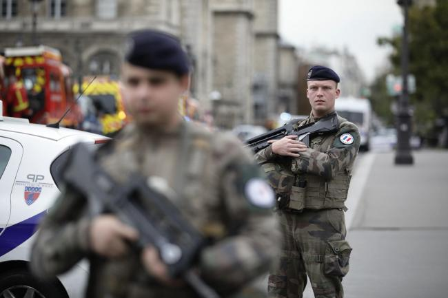 Police IT worker is suspect as four are killed in Paris bloodbath