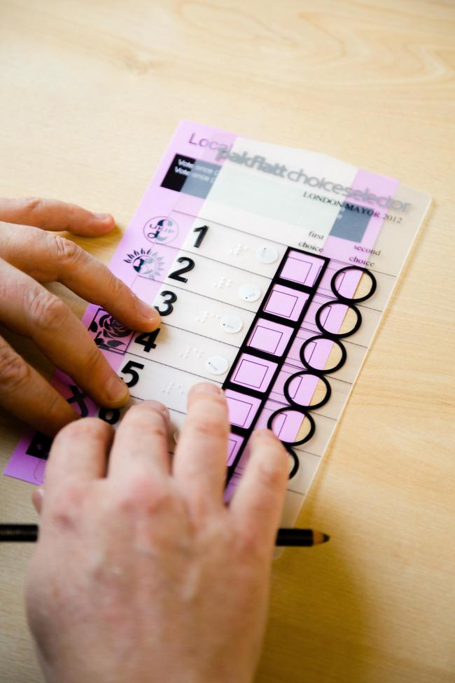Tactile voting device