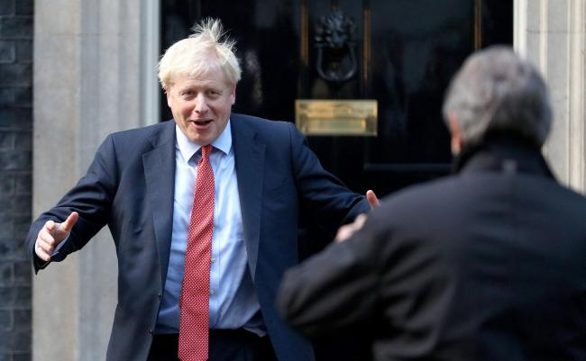 Boris Johnson greets European Parliament President David Sassoli outside Number 10.
