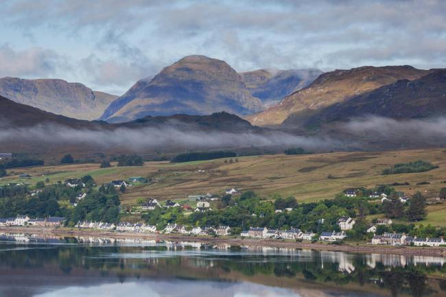The route includes  Lochcarron, pictured with Applecross Massif in the background.