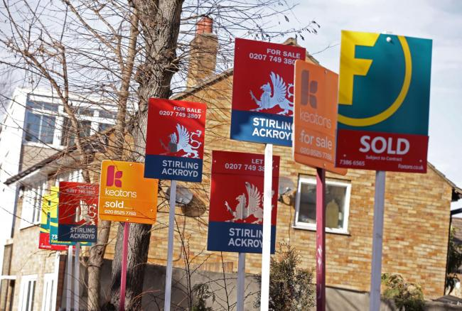 File photo dated 01/03/15 of a row of estate and letting agent signs displayed outside houses in Clapton, east London. The flow of homes coming on to the market is at its weakest level in three years as
